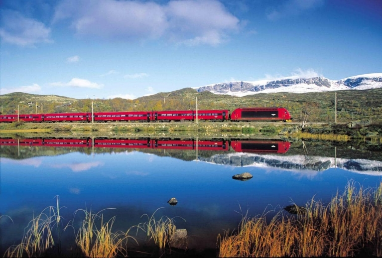 Travel by train in Norway, train passing a lake