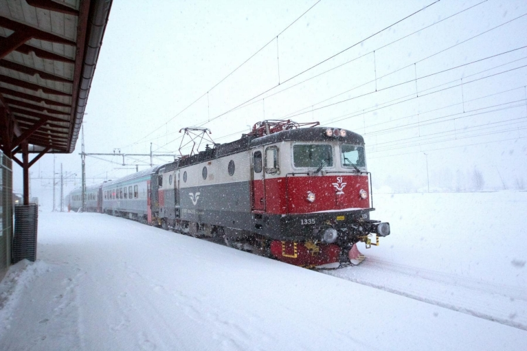 Swedish train travelling through snow