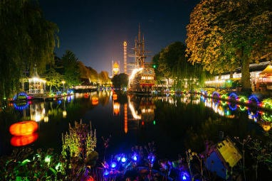 European destinations to spend Halloween | The lake at Tivoli gardens at night in Copenhagen, Denmark