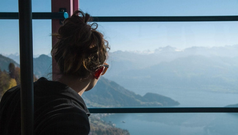 example_interrail_trip_-_girl_watching_the_view_of_mount_rigi_in_a_moving_cablecar_switzerland_5