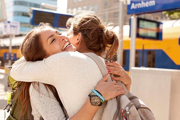 friends_hugging_at_arnhem_central_station_the_netherlands