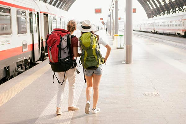 Young backpackers at station