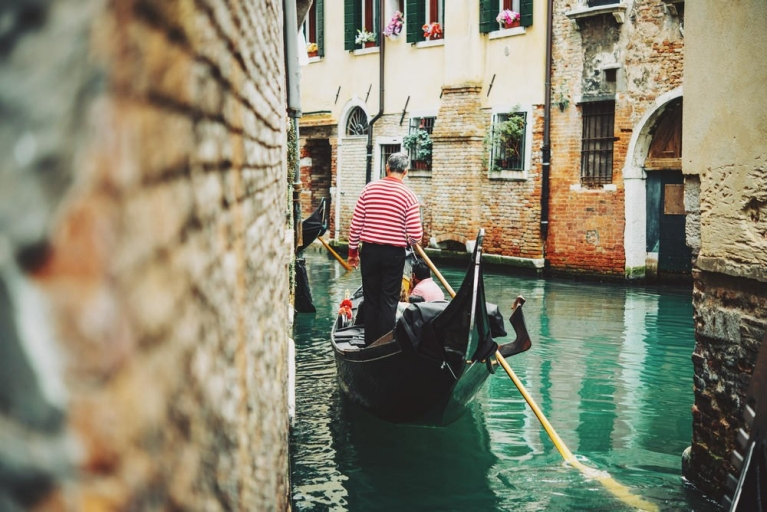 Enjoy a gondola ride through the captivating canals of Venice
