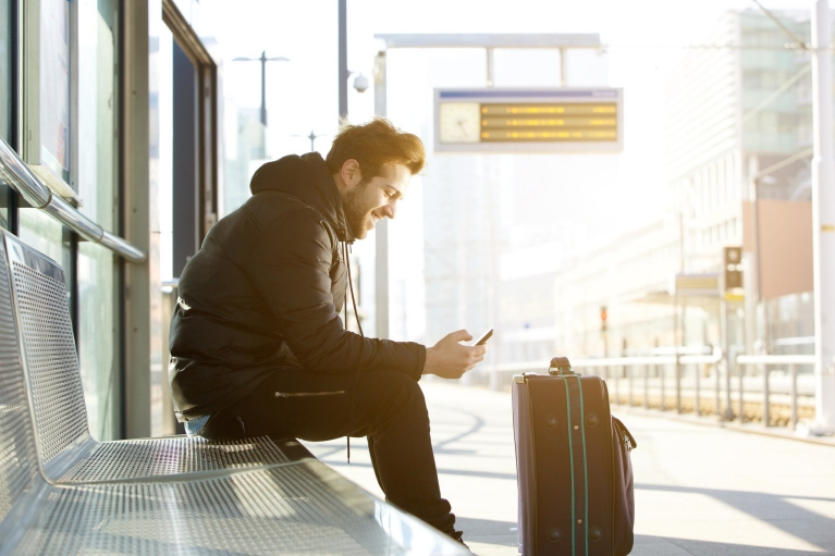 happy_man_waiting_for_train_