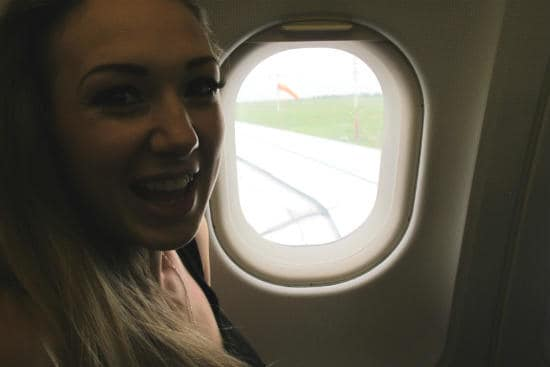 Interrail customer testimonials | Excited girl in the airoplane