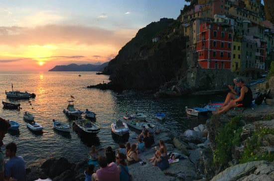 Interrail customer testimonials | People watching the sunset at Cinque Terre in Italy