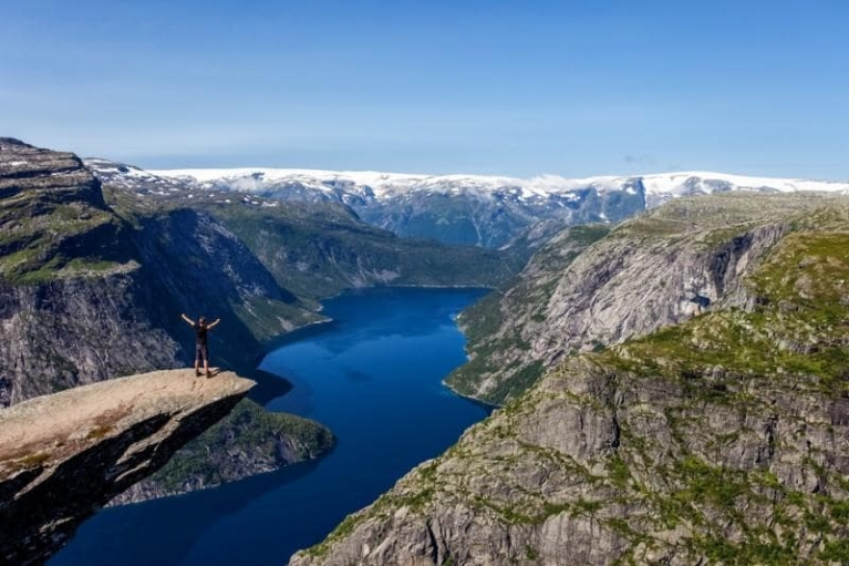 Man on top of Trolltunga in Norway