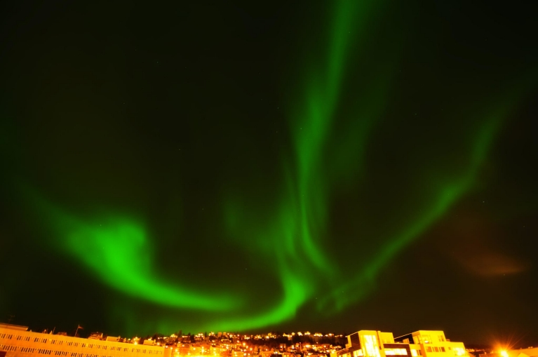 Northern lights above city of Tromsø