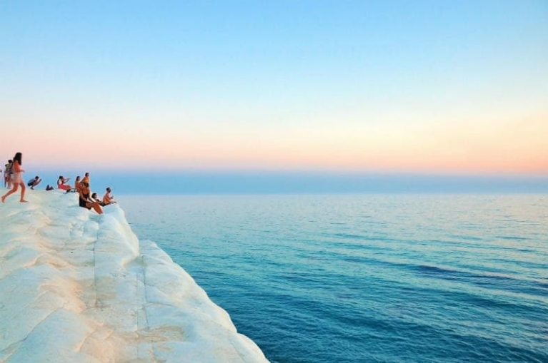 People standing on the white cliff at Scala dei Turchi in Realmonte